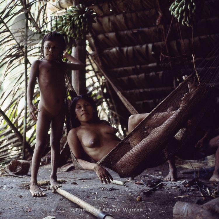 Waorani Indians, resting in hammock, Rio Cononaco, Ecuador, 1983
