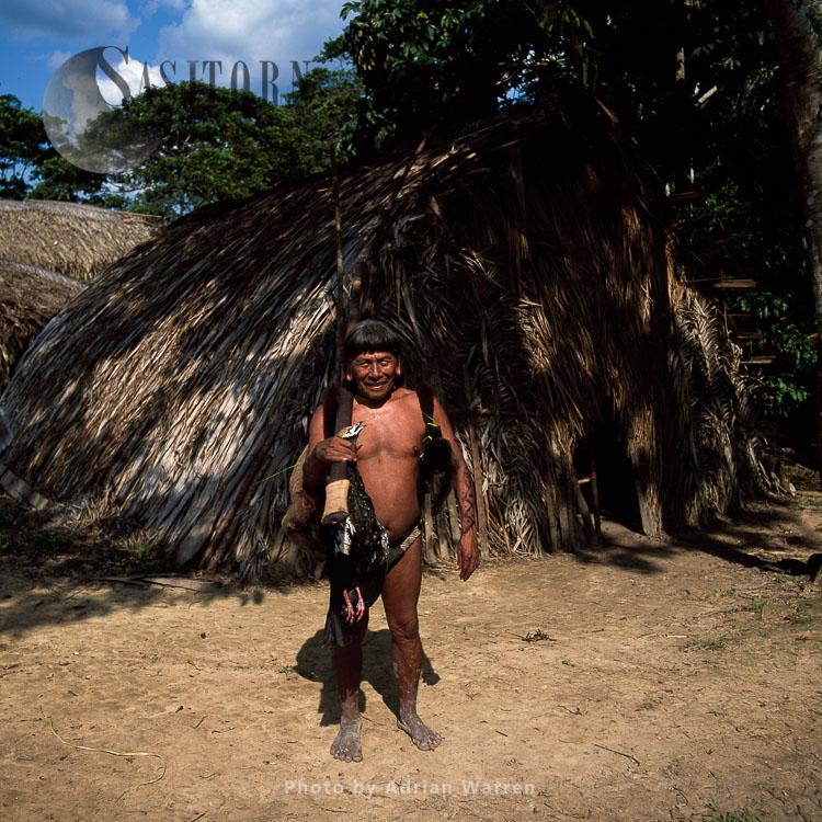 Waorani Indians : Caempaede after a sucessful hunt with Blowgun, Settlement near airstrip, rio Cononaco, Ecuador
