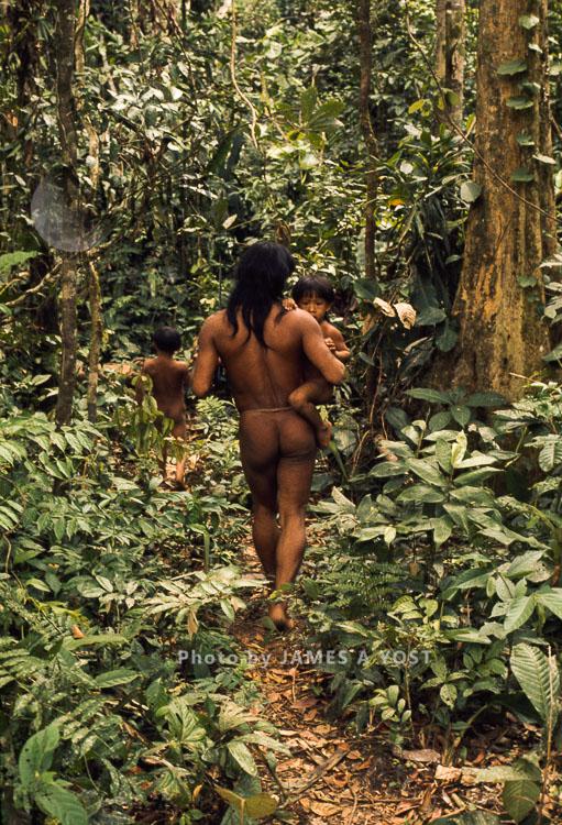Waorani Indians: Adult Man Carrying A Toddler, Gabado, 1975, Ecuador