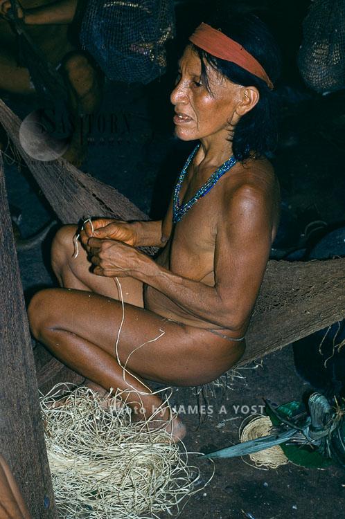 Waorani Indians: Spinning Dried Chambira Fibers Into Twine Fills Time During Socializing, Gabado, 1976, Ecuador