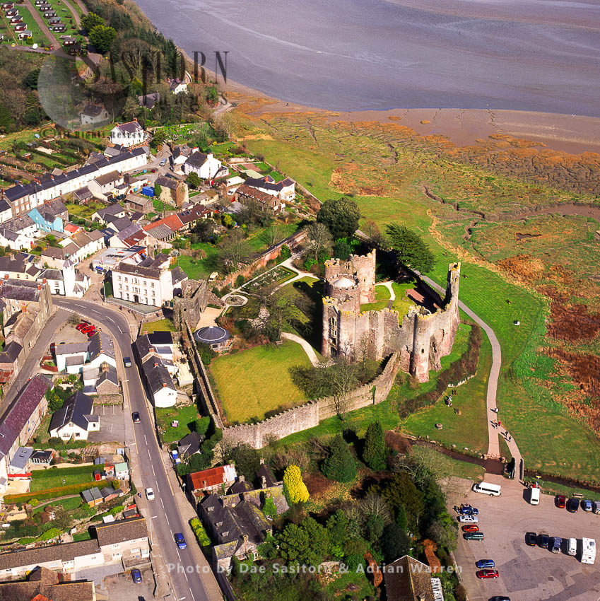 Laugharne Castle, In Town Of Laugharne, Carmarthenshire. Impressive Stone Ruin On The Estuary Of The River Taf, South Wales
