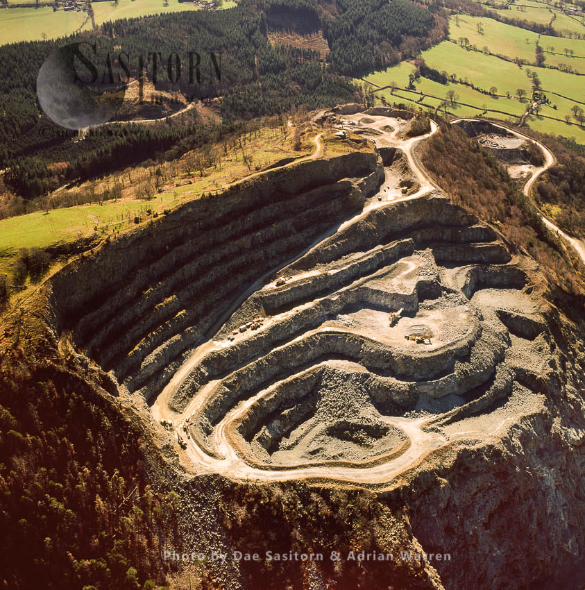 Criggion Quarry,, On Breiddon Hill, NE Of Welshpool, North Wales. The Quarry Is A Hard Rock Igneous Deposit (basalt) Mainly Use In The Road Construction Industry.