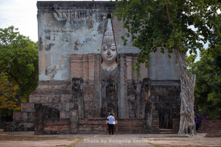 Wat Si Chum Is Remarkable For Its Huge Sitting Buddha Covered With Stucco In Sukhothai Historical Park, Sokhothai Province, Thailand.