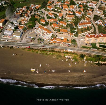 Beach And Boats Just East Of Port Of La Caleta, Caleta De Velez, Malaga, Southern Spain