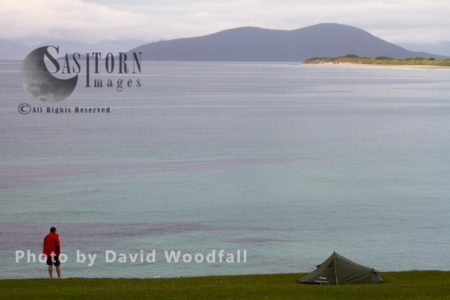 Man Camping On Machair Overlooking Sound Of Harris Enjoying 'wilderness' Experience ', Berneray, North Uist, Outer Hebrides
