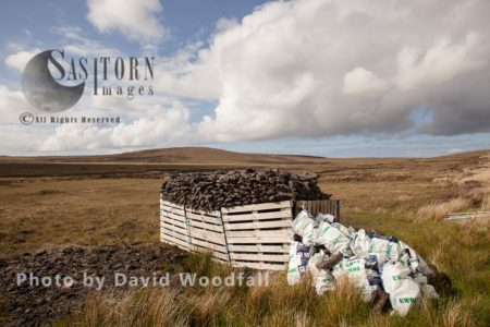 Hand Dug Peat In Stacks, Collected By Hand, For Domestic Use On Moorland. Berneray, North Uist, Outer Hebrides